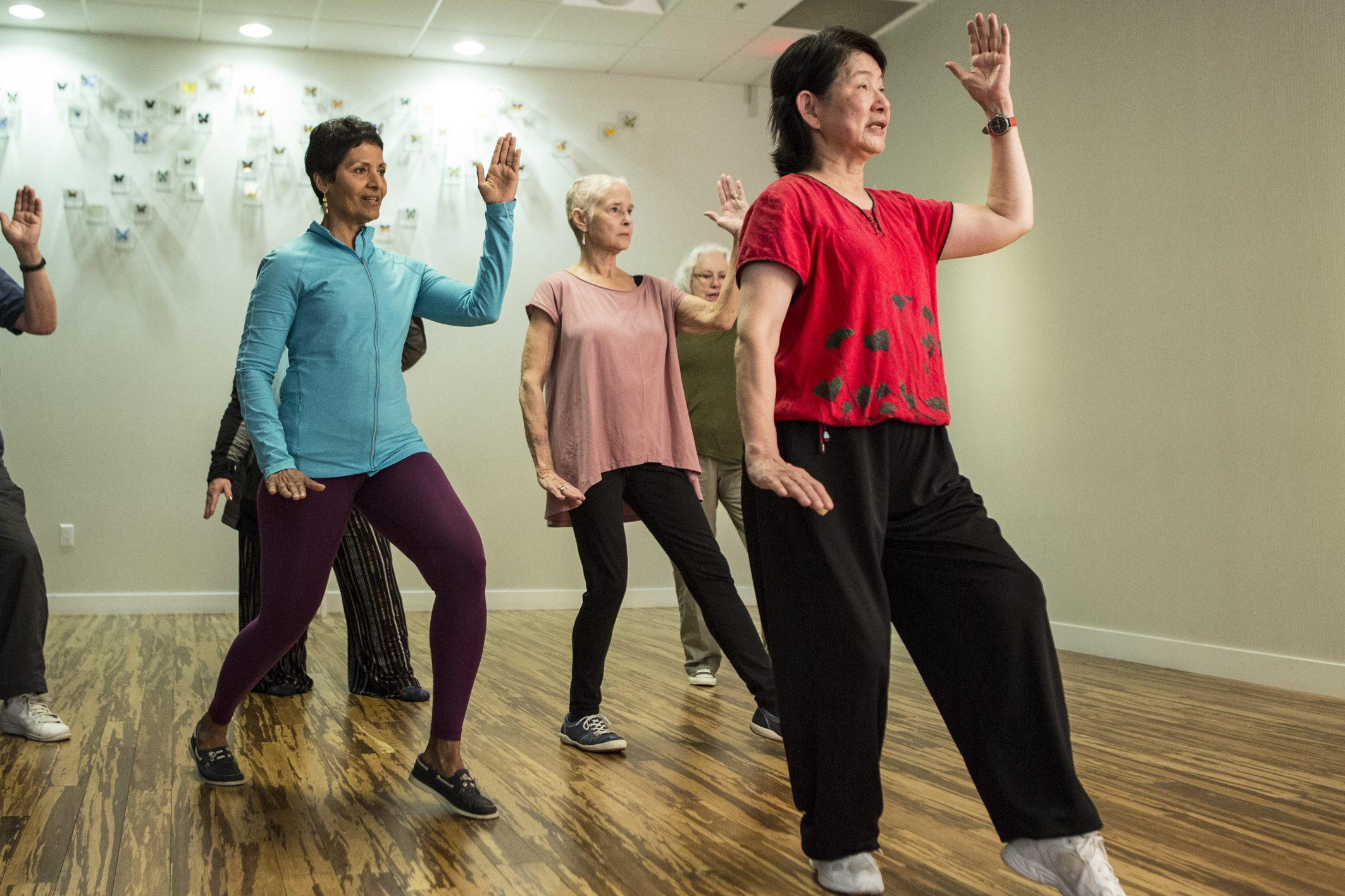 Multi diverse group demonstrating t'ai chi poses