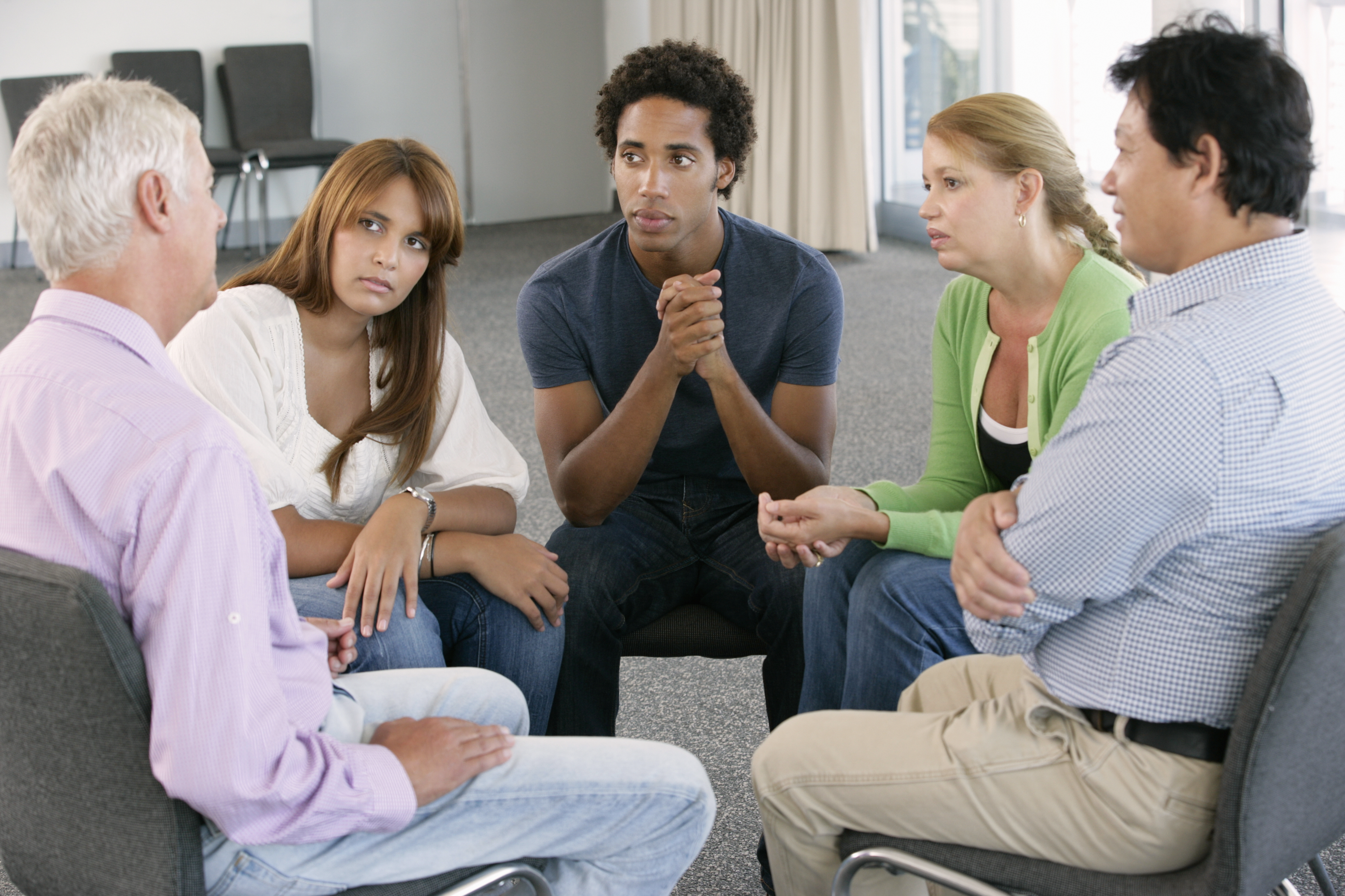 Meeting Of Support Group Listening To Member.